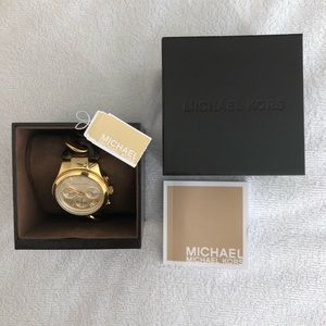 Watch by Michael Kors golf-tone.